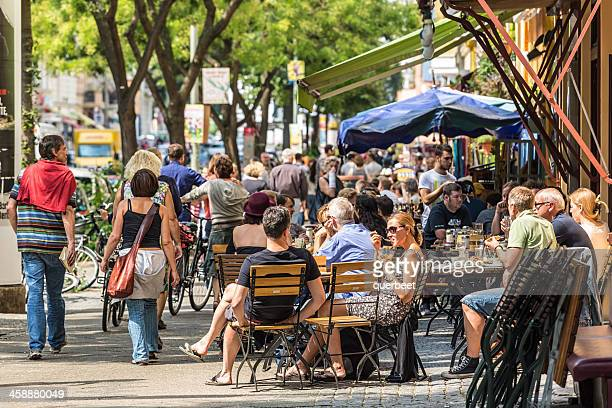 cafe with many people in berlin - kreuzberg stock photos and pictures