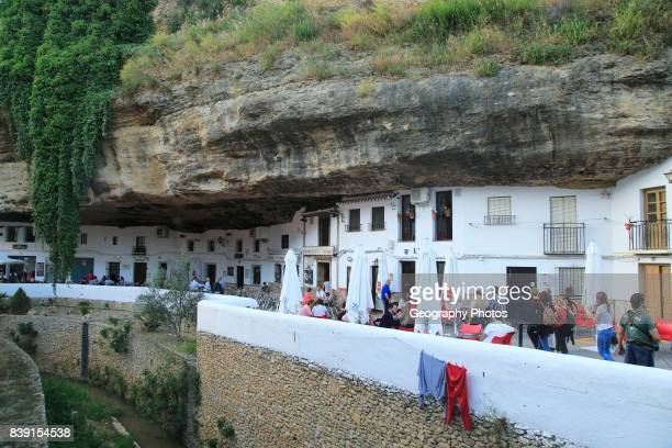 Cafes and shops under rock cave overhang, Setenil de las Bodegas, Cadiz province, Spain.