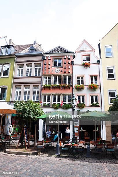 cafes in street marktstraße in düsseldorf - glockenspiel stock photos and pictures