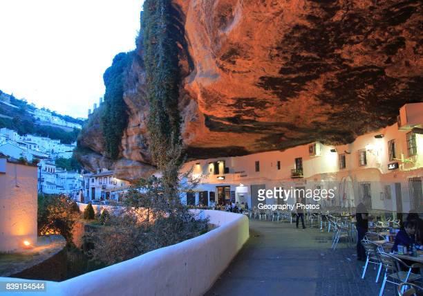 Cafes under rock cave overhang Setenil de las Bodegas Cadiz province Spain