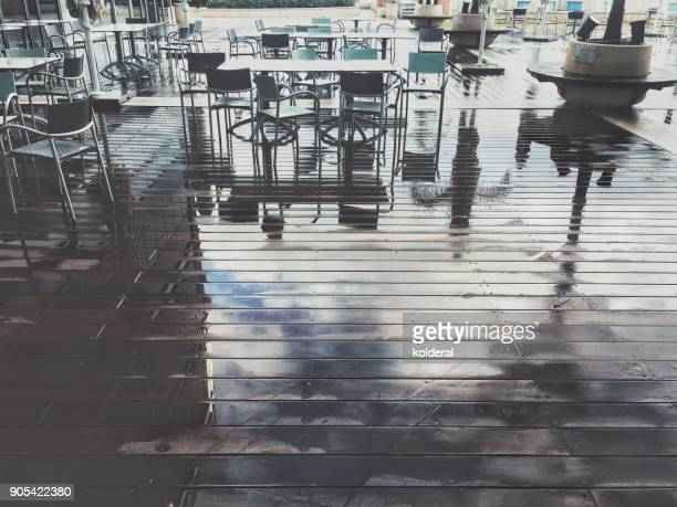 Cafeteria chairs and tables empty on the hardwood floor after the rain