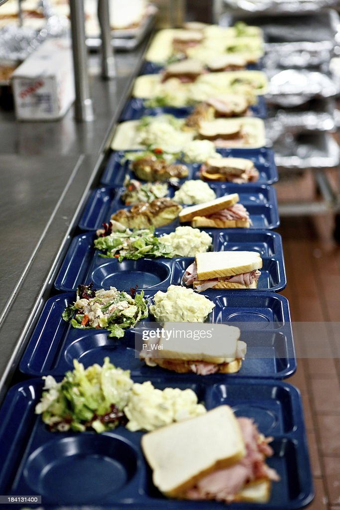 Cafeteria lunch assembly line : Stock Photo