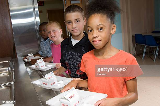 cafeteria school lunch line - milk carton stock photos and pictures