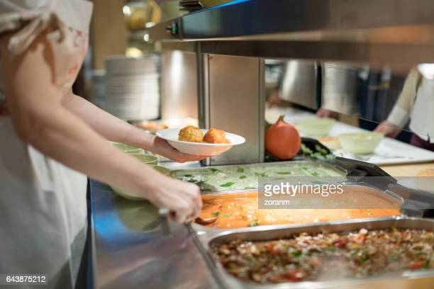 cafeteria worker serving lunch - food and drink industry stock photos and pictures