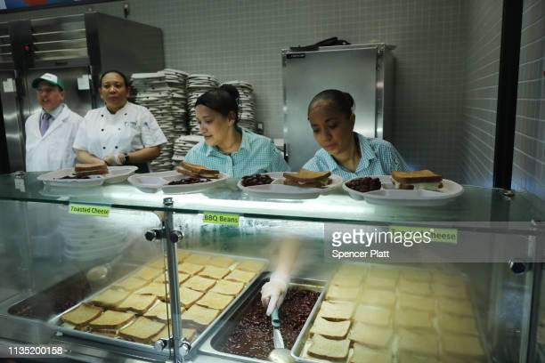 Cafeteria workers prepare a meatless lunch during a visit by New York Mayor Bill de Blasio and Schools Chancellor Richard Carranza at PS130 a...