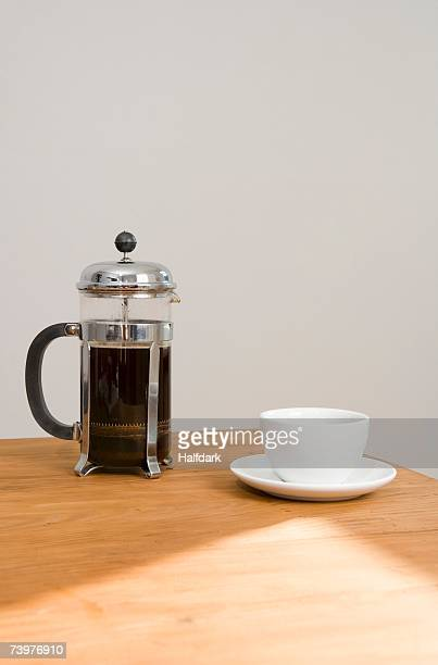 A cafetiere and coffee cup
