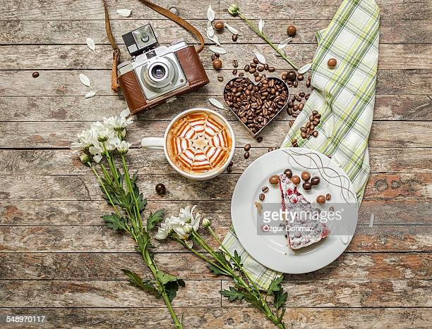 Caffee, coffee beans, cake with vintage camera