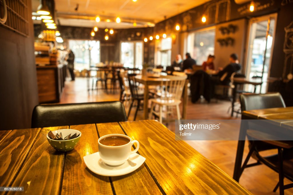 Caffee on table and blured cafe : Stock Photo