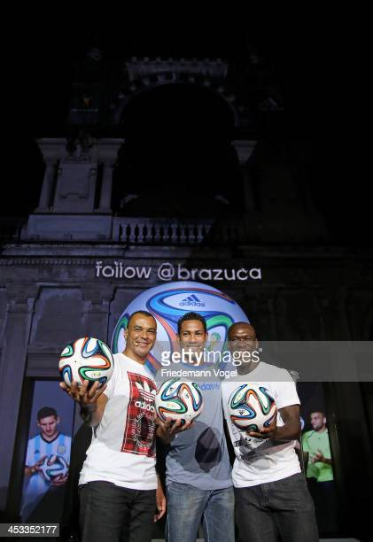 Cafu Hernane and Seedorf pose with the World Cup Brazuca ball during the adidas Brazuca launch at Parque Lage on December 3 2013 in Rio de Janeiro...