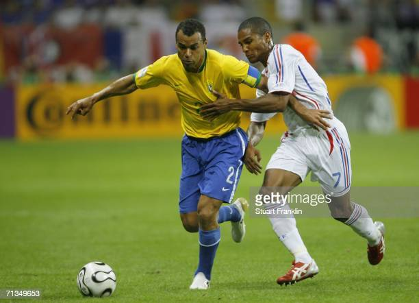 Cafu of Brazil battles for the ball with Florent Malouda of France during the FIFA World Cup Germany 2006 Quarterfinal match between Brazil and...