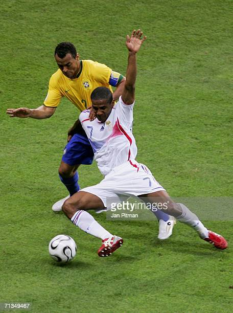 Cafu of Brazil battles with Florent Malouda of France for the ball during the FIFA World Cup Germany 2006 Quarterfinal match between Brazil and...