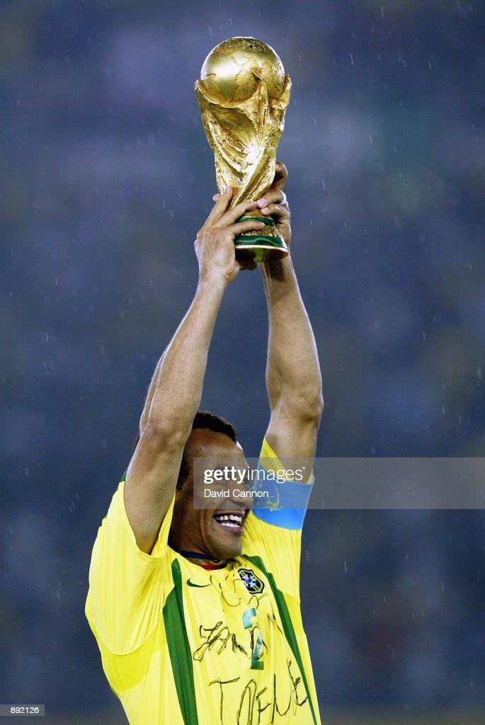 Cafu of Brazil lifts the trophy after the Germany v Brazil, World Cup Final match played at the International Stadium Yokohama in Yokohama, Japan on June 30, 2002. Brazil won 2-0.