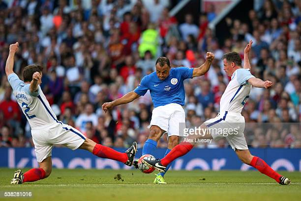 Cafu of Rest of the World has his shot blocked by Ben Shephard and Jamie Carragher of England during the Soccer Aid 2016 match in aid of UNICEF at...
