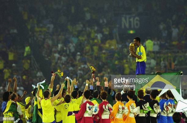 Cafu on the podium celebrates with the World Cup trophy after the World Cup Final match against Germany played at the International Stadium Yokohama...