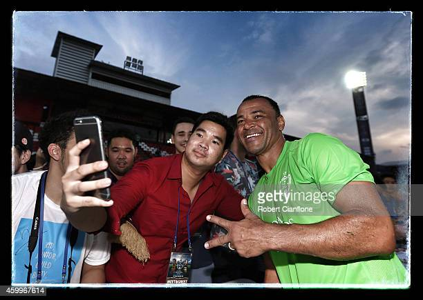 Cafu poses with a fan after a training session for the Global Legends Series at the SCG Stadium on December 4 2014 in Bangkok Thailand