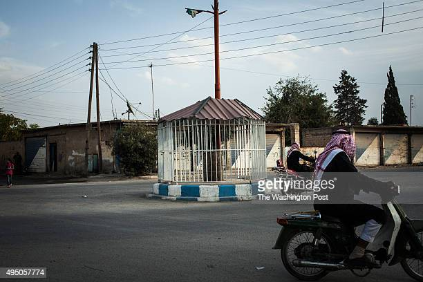 A cage where Islamic State militants temporarily held prisoners caught smoking while they held control of Tel Abyad in Raqqa province