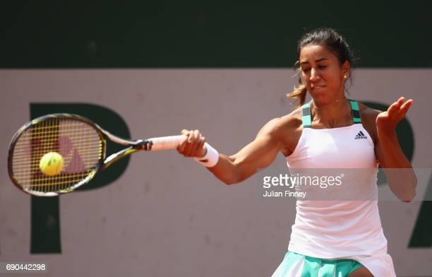 Cagla Buyukakcay of Turkey plays a forehand during the ladies singles second round match against Shelby Rogers of The United States on day four of...