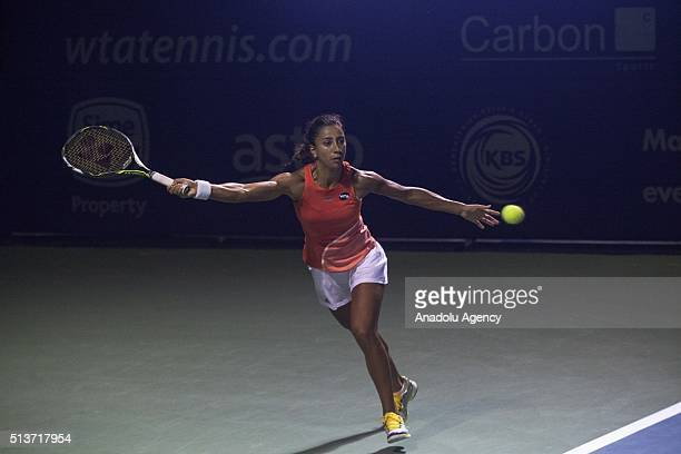 Cagla Buyukakcay of Turkey returns a ball to Eugenie Bouchard of Canada during a match in the women's singles tennis tournament of the WTA BMW...