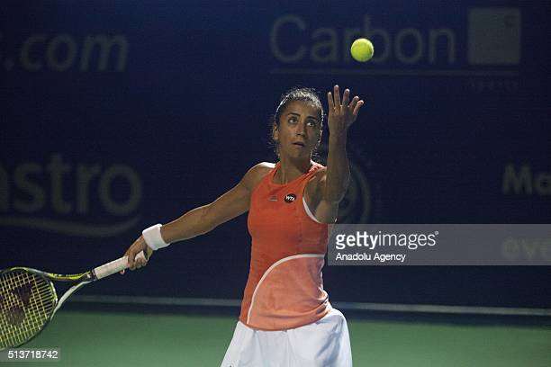 Cagla Buyukakcay of Turkey serves the ball to Eugenie Bouchard of Canada during a match in the women's singles tennis tournament of the WTA BMW...