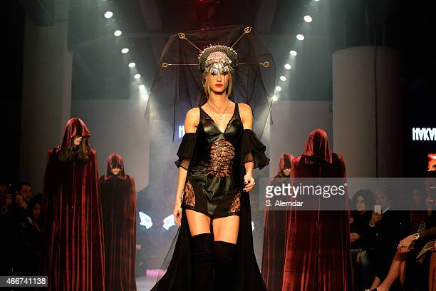 Cagla Sikel walks the runway at the Hakan Akkaya show during Mercedes Benz Fashion Week Istanbul FW15 on March 18 2015 in Istanbul Turkey