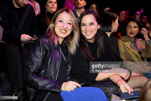 Cagla Sumnu and Sare Erdogan attend the Exquise show during MercedesBenz Fashion Week Istanbul March 2019 at Zorlu Center on March 22 2019 in...