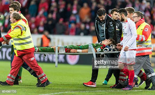 Caglar Soeyuencue of Freiburg is unconscious and is treated by the medics during the Bundesliga match between 1 FSV Mainz 05 and SC Freiburg at Opel...
