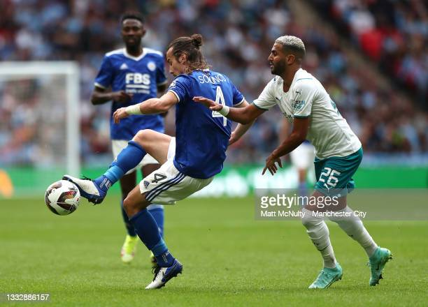 Caglar Soeyuencue of Leicester City battles for possession with Riyad Mahrez of Manchester City during The FA Community Shield Final between...