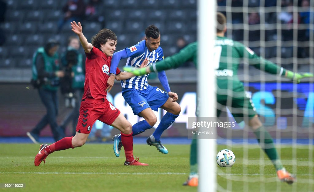 Caglar Soeyuencue of SC Freiburg and Davie Selke of Hertha BSC during the Bundesliga match between Hertha BSC and SC Freiburg at Olympiastadion on March 10, 2018 in Berlin, Germany.