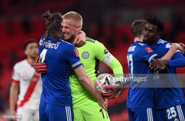 Caglar Soyuncu and Kasper Schmeichel of Leicester City celebrate following their team's victory in the Semi Final of the Emirates FA Cup between...