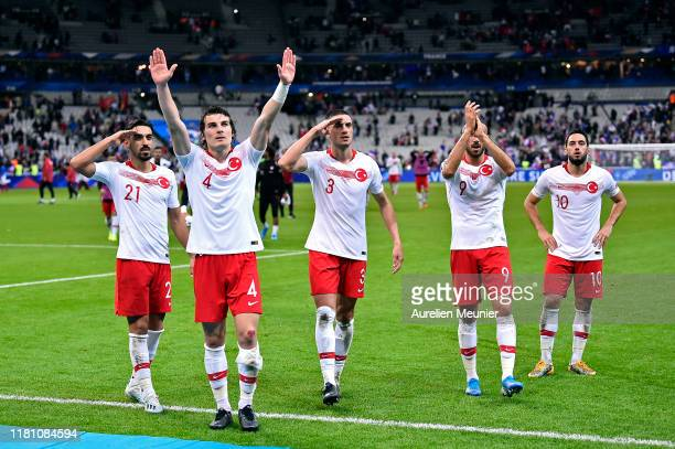 Caglar Soyuncu Irfan Can Kahveci Merih Demiral Cenk Tosun and Hakan Calhanoglu of Turkey celebrates with the fans after the UEFA Euro 2020 qualifier...
