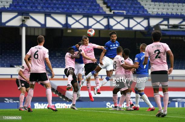 Caglar Soyuncu of Leicester City and Dominic Calvert-Lewin of Everton battle for the header during the Premier League match between Everton FC and...