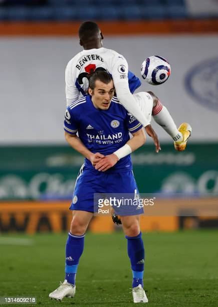 Caglar Soyuncu of Leicester City battles for possession with Christian Benteke of Crystal Palace during the Premier League match between Leicester...