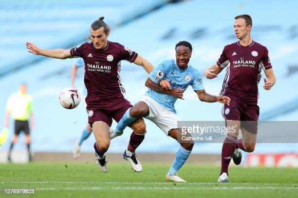 Caglar Soyuncu of Leicester City battles for possession with Raheem Sterling of Manchester City during the Premier League match between Manchester...