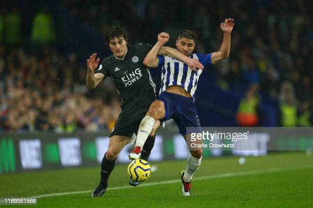 Caglar Soyuncu of Leicester City battles with Neal Maupay of Brighton and Hove Albion during the Premier League match between Brighton & Hove Albion...