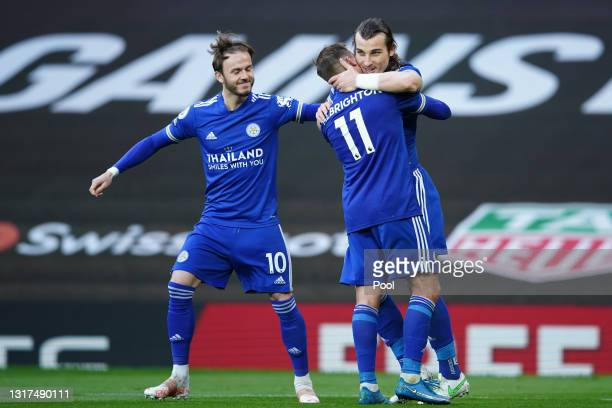 Caglar Soyuncu of Leicester City celebrates with team mates James Maddison and Marc Albrighton after scoring their side's second goal during the...