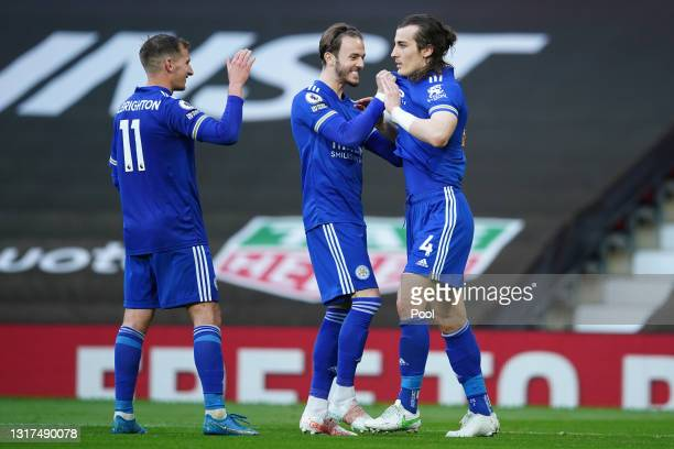 Caglar Soyuncu of Leicester City celebrates with team mates Marc Albrighton and James Maddison after scoring their side's second goal during the...