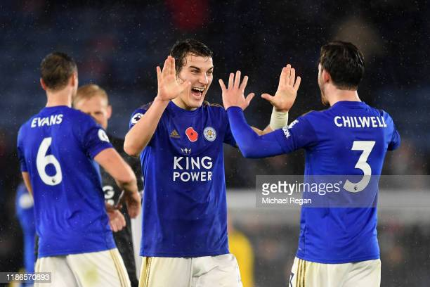 Caglar Soyuncu of Leicester City celebrates with teammate Ben Chilwell at fulltime following the Premier League match between Leicester City and...