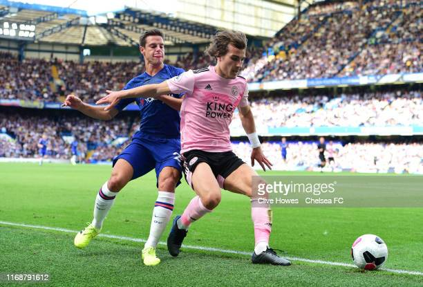 Caglar Soyuncu of Leicester City is challenged by Cesar Azpilicueta of Chelsea during the Premier League match between Chelsea FC and Leicester City...