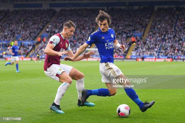 Caglar Soyuncu of Leicester City is challenged by James Tarkowski of Burnley during the Premier League match between Leicester City and Burnley FC at...