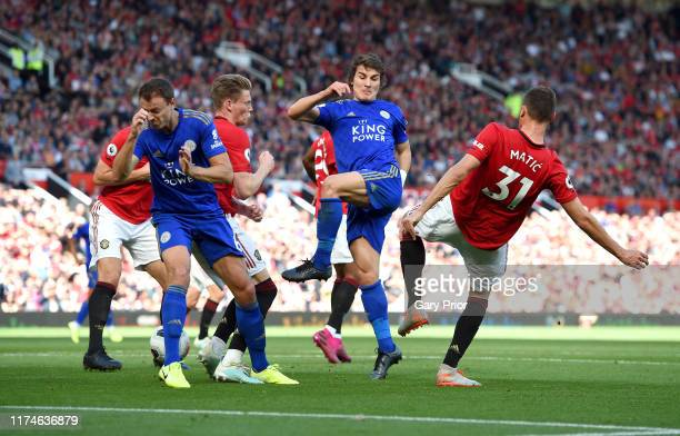 Caglar Soyuncu of Leicester City is challenged by Nemanja Matic of Manchester United as he shoots during the Premier League match between Manchester...