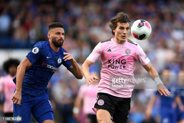 Caglar Soyuncu of Leicester City is challenged by Olivier Giroud of Chelsea during the Premier League match between Chelsea FC and Leicester City at...