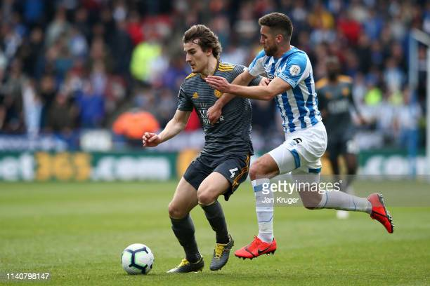 Caglar Soyuncu of Leicester City is challenged by Tommy Smith of Huddersfield Town during the Premier League match between Huddersfield Town and...