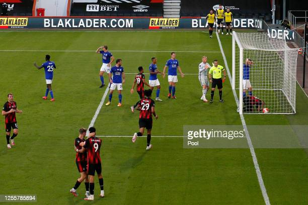 Caglar Soyuncu of Leicester City is shown the red card as AFC Bournemouth celebrate during the Premier League match between AFC Bournemouth and...