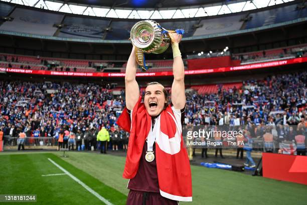Caglar Soyuncu of Leicester City lifts the Emirates FA Cup trophy following The Emirates FA Cup Final match between Chelsea and Leicester City at...