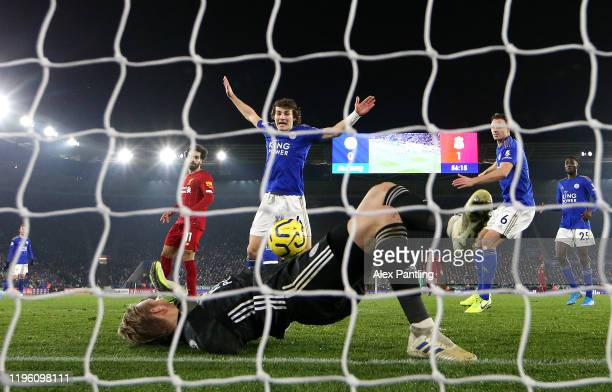 Caglar Soyuncu of Leicester City reacts as Kasper Schmeichel of Leicester City makes a save during the Premier League match between Leicester City...