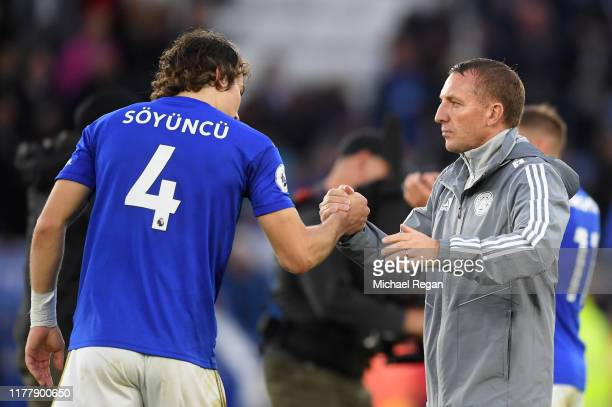 Caglar Soyuncu of Leicester City shakes hands with Brendan Rodgers Manager of Leicester City during the Premier League match between Leicester City...