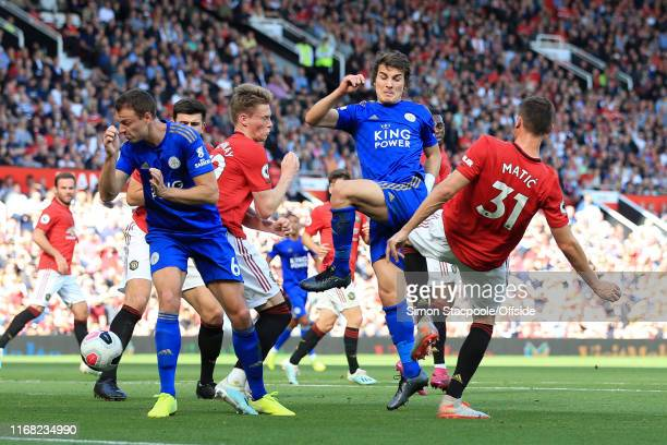 Caglar Soyuncu of Leicester shoots past Nemanja Matic of Man Utd during the Premier League match between Manchester United and Leicester City at Old...
