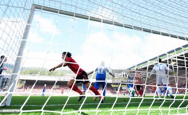 Caglar Soyuncu of SC Freiburg scores a goal past Oliver Baumann of 1899 Hoffenheim during the Bundesliga match between SportClub Freiburg and TSG...