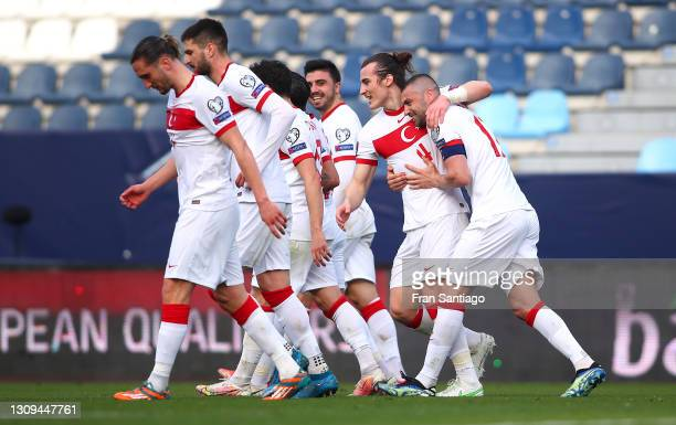 Caglar Soyuncu of Turkey celebrates with teammates after scoring their team's second goal during the FIFA World Cup 2022 Qatar qualifying match...