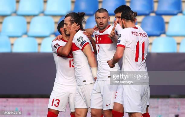 Caglar Soyuncu of Turkey celebrates with Umut Merao, Burak Yılmaz and Yusuf Yazici after scoring their team's second goal during the FIFA World Cup...